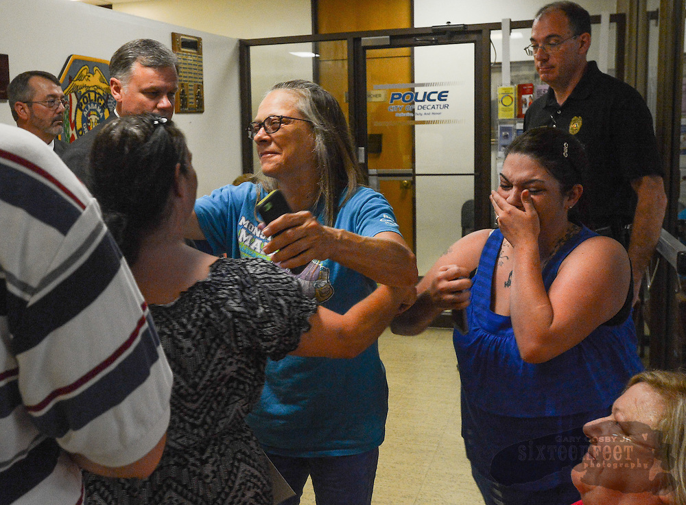 Murder victim Joshua Dewayne Davis' family reacts to the news that capital murder charges had been filed against four suspects in his death. Davis' mother Renee Davis (back to the camera) is hugged by Debbie Halls while Davis' sister April Davis cries with joy.