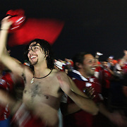 Fans celebrate the Chilean 2-0 win over Spain on  Copacabana Beach at the World Cup in Rio on Saturday, June 18, 2014.  Credit: Byron Smith