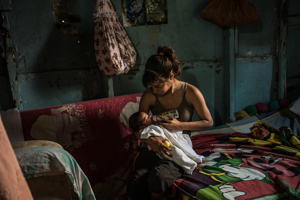 CARACAS, VENEZUELA - MARCH 20, 2016: The afternoon her water broke, 19-year old Yanny Trejo did not rush to the hospital, but stayed at her sweltering shack home in a slum high on a hill overlooking Caracas until she knew she was nearly ready to give birth. Then she climbed the steep stairs out of the slum and made the 30-minute trip to the state-run Concepci&oacute;n Palacios maternity hospital.  Friends who had recently given birth advised her not to arrive too early. &ldquo;You have to arrive when your baby is just about to crown&hellip;if not, they will send you away to another hospital, then that hospital will send you to another, and it just keeps going&rdquo; Trejo told IRIN.  Doctors at the hospital admit they are working with limited resources and frequently have to turn away women in labour. &ldquo;The reality is that we only have the capacity to accept patients in the moment when they are about to deliver,&rdquo; said one of the doctors, Moraima Hern&aacute;ndez. &ldquo;Patients have to play roulette with various hospitals to receive medical attention.&rdquo;<br />  PHOTO: Meridith Kohut for IRIN News