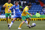 Oldham - Saturday February 26th, 2010 :  Wes Hoolahan of Norwich and Dale Stephens of Oldham in action during the Coca Cola League One match at Boundary Park, Oldham. (Pic by Paul Chesterton/Focus Images)..