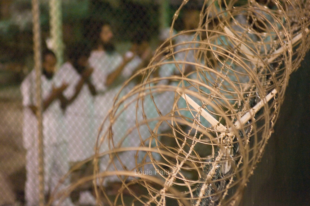 Detainees seen during the morning group prayer in Camp 4, which houses the most cooperative detainees at the Guantanamo Bay Detention Facility located on the US Naval Station in Guantanamo Bay, Cuba. Approximately 240 detainees accused of plotting and assisting in terrorist activities continue to be held in the facility after the attacks on the United States on September 11, 2001, while some are cleared for release. The US administration is working toward a solution as to the future of many of the detainees after US President Barack Obama signed an order to close the detention facility earlier this year.