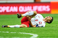 Warsaw, Poland - 2017 September 04: Robert Lewandowski from Poland lies on the pitch and holds his tibia during soccer match Poland v Kazakhstan - FIFA 2018 World Cup Qualifier at PGE National Stadium on September 04, 2017 in Warsaw, Poland.<br /> <br /> Adam Nurkiewicz declares that he has no rights to the image of people at the photographs of his authorship.<br /> <br /> Picture also available in RAW (NEF) or TIFF format on special request.<br /> <br /> Any editorial, commercial or promotional use requires written permission from the author of image.<br /> <br /> Mandatory credit:<br /> Photo by © Adam Nurkiewicz / Mediasport