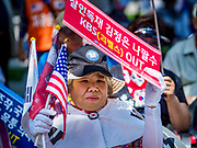 16 JUNE 2018 - SEOUL, SOUTH KOREA: South Korean evangelical Christians pray before a protest against South Korean President Moon Jae-in. Many of the protesters, who were mostly Christians, support jailed former President Park Geun-hye. President Moon Jae-in was elected in 2017 after Park was impeached, tried and convicted on corruption charges. The protesters allege that Moon is too soft on North Korea and can't be trusted to negotiate with North Korean leader Kim Jong-un. They support US President Donald Trump's efforts to negotiate with the North Korean strongman.    PHOTO BY JACK KURTZ