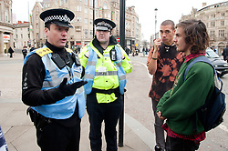 South Yorkshire Police liaison Officer speaks to demonstrators outside the Liberal Democrat party Conference in Sheffield Friday Afternoon.11 March 2011.Images © Paul David Drabble