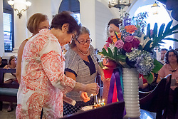 Marilyn Blackhall, Trudy Prior, Katina Coulianos, and Stella Minion kindle the Sabbath lights to commemorate the 49 victims of the Orlando massacre.  LGBT Pride & Vigil Service in Remembrance of the Victims of the Orlando Massacre with the Hebrew Congregation of the St.Thomas.  17 June 2016.  © Aisha-Zakiya Boyd