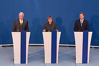 12 NOV 2003, BERLIN/GERMANY:<br /> Edmund Stoiber (L), CSU, Ministerpraesidnet Bayern, Angela Merkel (M), CDU Bundesvorsitzende, und Guido Westerwelle (R), FDP Bundesvorsitzender, waehrend einer Pressekonferenz zu dem vorangegangenen  Spitzentrfffen von Politiker der CDU/CSU und der FDP, axica Kongress- und Tagungszentrum<br /> IMAGE: 20031112-01-031<br /> KEYWORDS: Opposition, Spitzengespraech