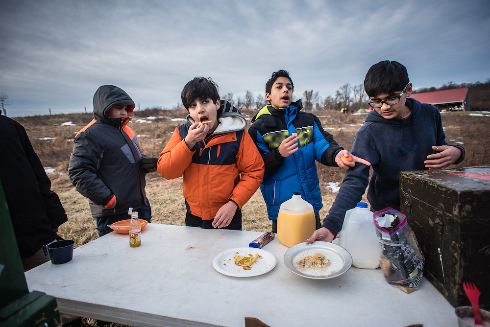 PURCELLVILLE, VA -- FEBRUARY 13: From left: Noor El Deen Abdalla, 11, Sultan Behgoman, 13, Esam Yousuf, 13, and Amaan Rahman, 13, eat eggs and cereal for breakfast.<br /> <br /> Boy Scout Troop 1576 attends the 2016 Freeze-O-Ree. Troop 1576 is connected to the All Dulles Area Muslim Society. The mosque, which is one of the largest in the country, is home to one of the largest Boy Scout Troops in the region..&hellip;. (photo by Andre Chung for The Washington Post)