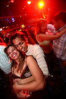 A group of friends enjoy a night at a disco in the Zona Rosa in north Bogotá on Friday, May 4, 2007. (Photo/Scott Dalton)