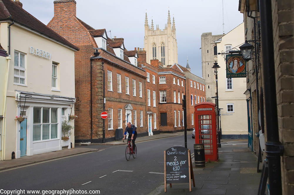 Tower of Saint Edmundsbury Cathedral above a street of historic buildings, Bury St Edmunds, Suffolk, England
