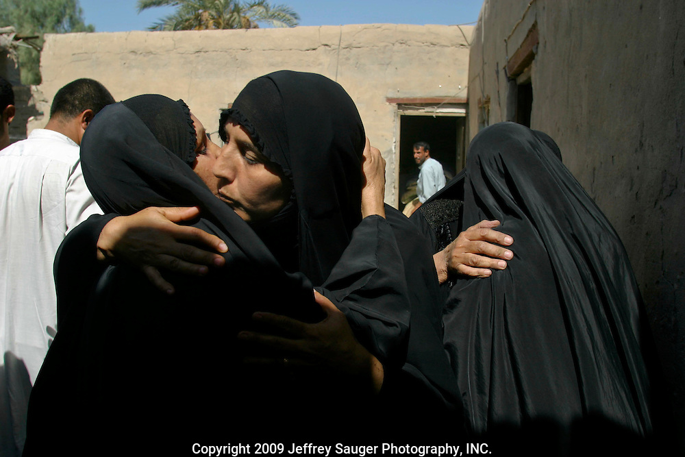 Kawther Al-Kasid, center, greets a friend during the Al-Kasid family's Istikbal, or homecoming, in their home village Suq ash Shuyukh on the outskirts of Nasiriyah, Iraq, July 30, 2003. The celebration lasts three days with different tribal chiefs, family members and friends coming and going. ..The Al-Kasid family fled Iraq after the Gulf War and their part in the uprising against Saddam Hussein in 1991, spent 3 years in Rafa, Saudi Arabia and finally settled in Dearborn, MI. The family hasn't been home to Iraq in 13 years.