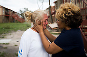 """Genice Gipson comforts her """"lifelong friend,"""" Loretta Capistran, outside of Capistran's apartment complex in Refugio, Texas, on Monday, August 28, 2017. Capistran hunkered down in her apartment's closet as Hurricane Harvey's 140-MPH winds tore through the Texas coast and anything that sat in its path. """"We got to be strong, baby,"""" Gipson told Capistran. NICK WAGNER / AMERICAN-STATESMAN"""