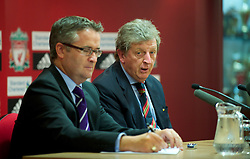LIVERPOOL, ENGLAND - Wednesday, August 18, 2010: Liverpool's manager Roy Hodgson and press officer Paul Tyrell during a press conference at Anfield ahead of the UEFA Europa League Play-Off 1st Leg match against Trabzonspor A.S. (Pic by: David Rawcliffe/Propaganda)