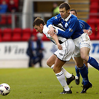 St Johnstone v Dunfermline   12.01.02<br />Craig Russell gets a piggy back ride from Andreus Skerla<br /><br />Pic by Graeme Hart<br />Copyright Perthshire Picture Agency<br />Tel: 01738 623350 / 07990 594431
