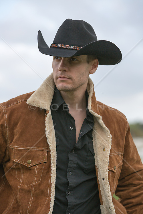 rugged and handsome cowboy on a ranch