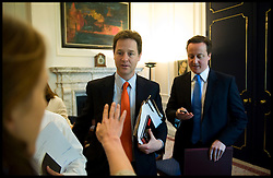 British Prime Minister David Cameron with the Deputy Prime Minister Nick Clegg working in the Prime Minister's office in Number 10 Downing Street, Wednesday May 19, 2010. Photo By Andrew Parsons/i-Images