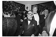 SWIFTY LAZAR WITH BODYGUARD BEHIND at Swifty Lazar's Oscar Night party. Spago. Los Angeles. March 1990.<br /> <br /> © Copyright Photograph by Dafydd Jones<br /> 66 Stockwell Park Rd. London SW9 0DA<br /> Tel 0171 733 0108<br /> Film 90231/36