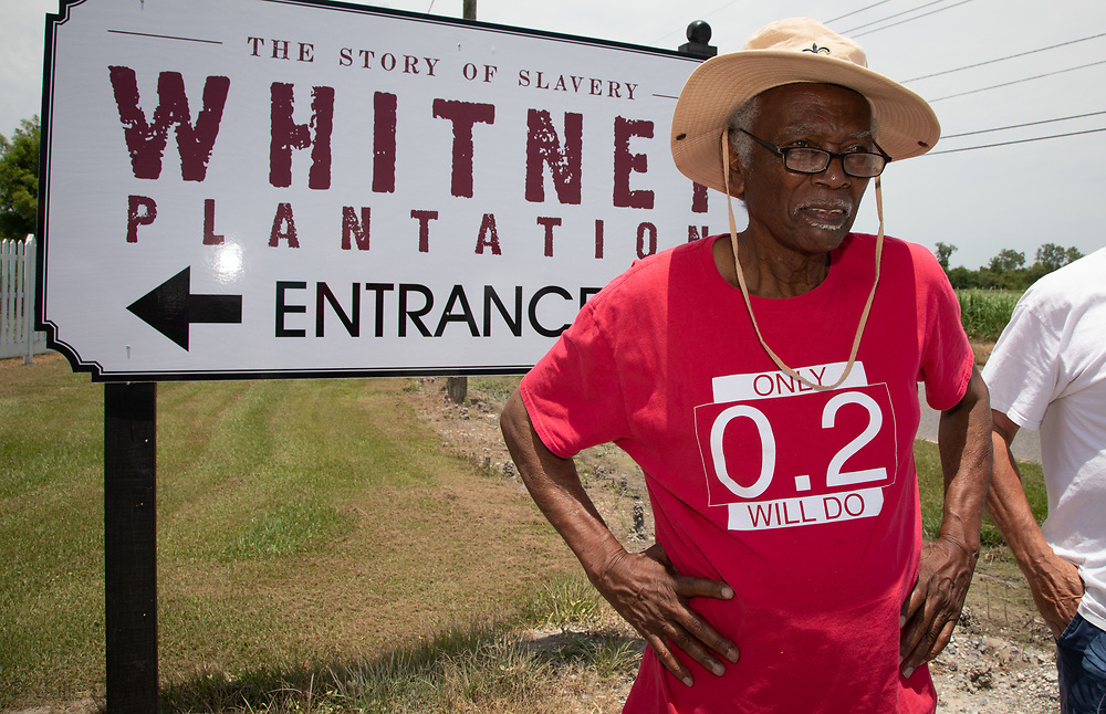 """Robert Taylor with members of CADA and supporters in front of the Whitney Plantation, on the first day  of the Coalition Against Death Alley's 5 day march. The Coalition Against Death Alley (CADA), is a group of Louisiana-based residents and members of various local and state organizations, is calling for a stop to the construction of new petrochemical plants and the passing of stricter regulations on existing industry in the area that include the groups RISE St. James, Justice and Beyond, the Louisiana Bucket Brigade, 350 New Orleans, and the Concerned Citizens of St. John.  Louisiana's Cancer Alley, an 80-mile stretch along the Mississippi River, is also known as the """"Petrochemical Corridor,"""" where there are over 100 petrochemical plants and refineries."""