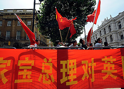 © licensed to London News Pictures. LONDON, UK.  27/06/11. Pro China supporters outside Downing Street. A protest was held outside Downing Street  today (27 June2011). The protest was aimed at the Chinese Premier, Wen Jiabao, who was visiting British Prime Minister David Cameron. Pro China and Free Tibet protesters where present. today (27 June2011). Mandatory Credit Stephen Simpson/LNP