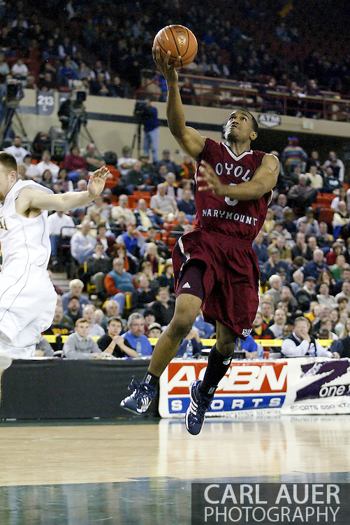 11/22/2006 - Anchorage, Alaska: Senior guard Brandon Worthy (0) of the Loyola Marymount Lions goes for a easy lay-up as Loyola Marymount defeats the University of Alaska-Anchorage 69-58 in the first game of the 2006 Great Alaska Shootout<br />