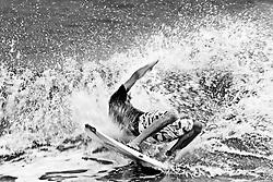 Surfers take advantage of the waves after Hurricane Irene passes South Carolina.