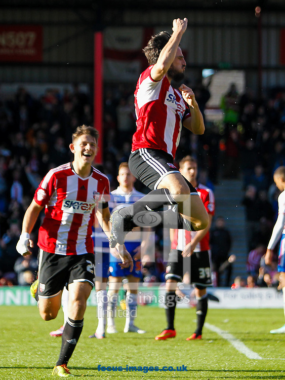 Jonathan Douglas of Brentford celebrates scoring his side's third goal during the Sky Bet Championship match between Brentford and Reading at Griffin Park, London<br /> Picture by Mark D Fuller/Focus Images Ltd +44 7774 216216<br /> 04/10/2014