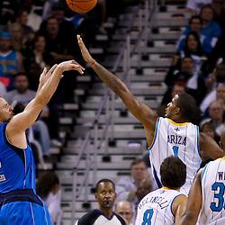 November 17, 2010; New Orleans, LA, USA; Dallas Mavericks point guard Jason Kidd (2) shoots over New Orleans Hornets small forward Trevor Ariza (1) during the second half at the New Orleans Arena. The Hornets defeated the Mavericks 99-97. Mandatory Credit: Derick E. Hingle