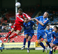 Photo: Chris Ratcliffe.<br />Leyton Orient v Boston United. Coca Cola League 2. 08/04/2006.<br />Donny Barnard (L) of Leyton Orient goes up to head a ball goalwards as Simon Rusk (R) and Lee Canoville of Boston (C) try to close him down