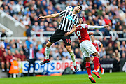 Federico Fernandez (#18) of Newcastle United stretches his neck to head the ball clear of Alexandre Lacazette (#9) of Arsenal during the Premier League match between Newcastle United and Arsenal at St. James's Park, Newcastle, England on 15 September 2018.