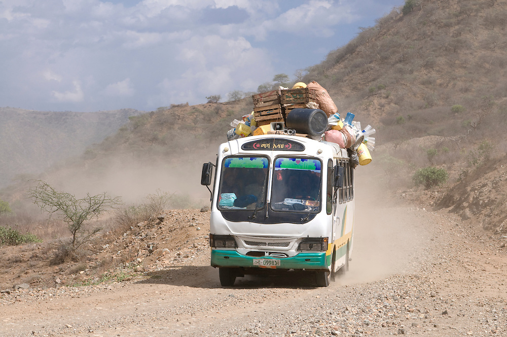 Loaded bus on a dusty road in Southern Ethiopia,Africa