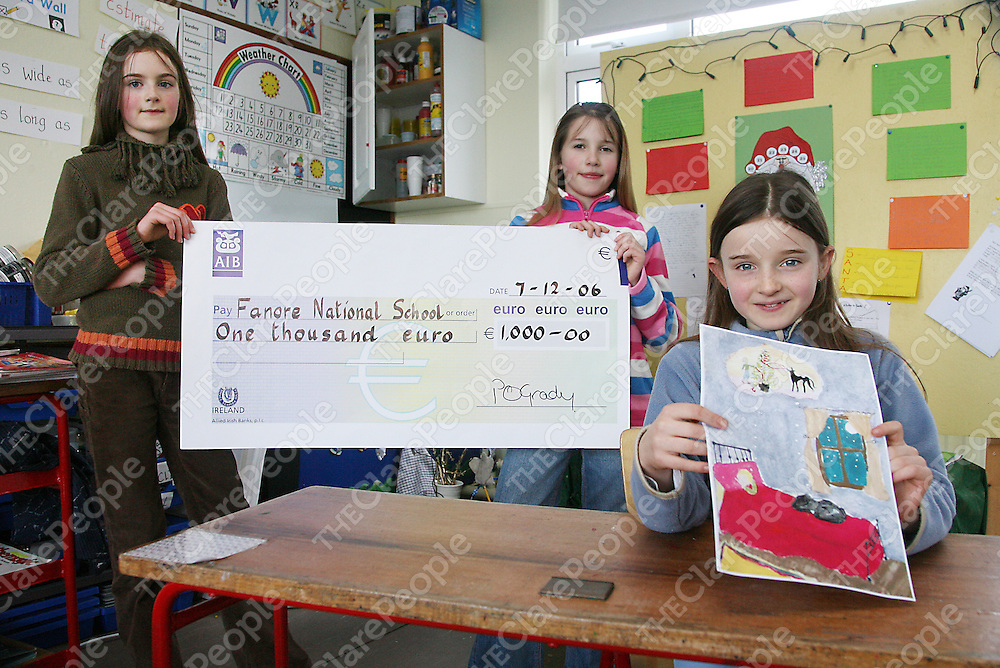Nora and Anne Casey hold up the cheque worth &euro;1000 which Hannah Casey won for Fanore NS when she came first in the country for designing a card 'Greyhounds For Pets' run by the Nationl Greyhound Association.<br />
