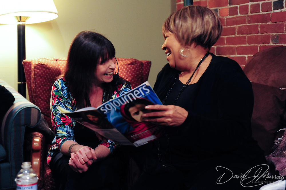 Mavis Staples (R) and Yvonne Staples (L) learn of an article about Mavis in Sojourners Magazine from Deb Pickett (center), in the green room backstage at The Music Hall in Portsmouth, NH, where Deb is House Manager.