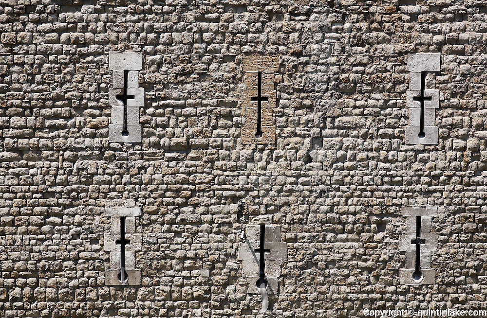 Arrow slits in the Tower of London's outer curtain wall built by Edward I between 1275 and 1285. London, UK, 2009