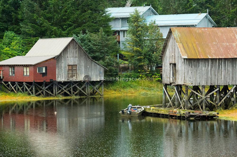 Houses built on piers rise above a waterway in Petersburg, Alaska.