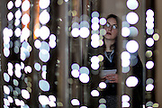 "© Licensed to London News Pictures. 29/01/2013. London, UK A woman looks at ""Cylinder 2011"" by Leo Villareal. Press preview of ""Light Show"" at the Hayward Gallery at the Southbank Centre in London today 29th January 2013. The exhibition runs 30th Jan-28th Apr 2013. Photo credit : Stephen Simpson/LNP"