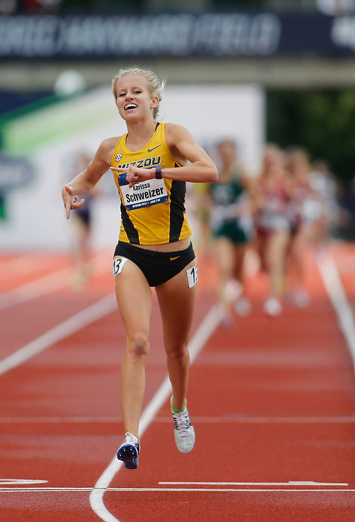 Missouri Karissa Schweizer smiles as she crosses the finish line to win the women's 5000 meters in the time of 15 minutes, 38.93 seconds on the final day of the NCAA outdoor college track and field championships in Eugene, Ore., Saturday, June 10, 2017. (AP Photo/Timothy J. Gonzalez)