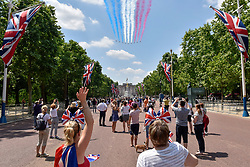 © Licensed to London News Pictures. 17/06/2017. London, UK. Large crowds gather in The Mall to watch the Red Arrows fly past which takes place after the Trooping of the Colour. Photo credit : Stephen Chung/LNP