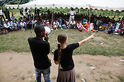 South African program co-ordinator Tamlin Abrahams and local volunteers announce from the Operation schedule whether or not patients have been successful for surgery...Operation Smile South Africa.Clinique Ngaliema, Avenue Des Cliniques.KInshasa, DRC Mission, June 3rd-12th 2011..© Zute & Demelza Lightfoot.www.lightfootphoto.com...