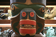 First Nations totem carving for sale in shop in Gastown, popular tourism district in downtown Vancouver, British Columbia, Canada.