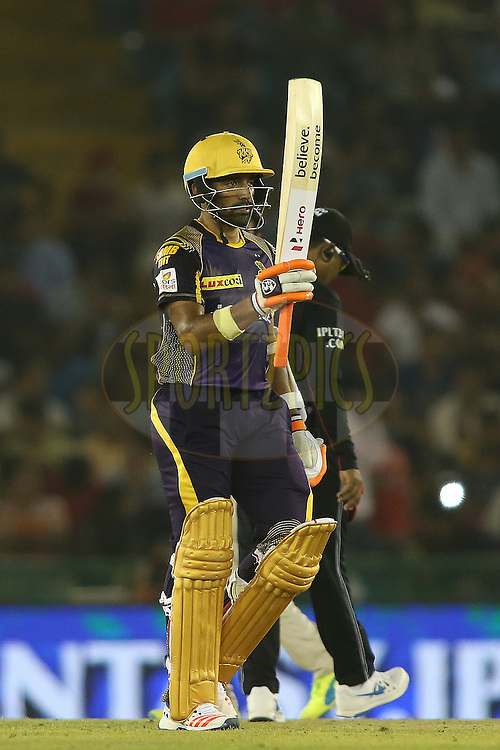 Robin Uthappa of Kolkata Knight Riders raises his bat after reaching his fifty during match 13 of the Vivo Indian Premier League (IPL) 2016 between the Kings XI Punjab and the Kolkata Knight Riders held at the IS Bindra Stadium, Mohali, India on the 19th April 2016<br /> <br /> Photo by Shaun Roy / IPL/ SPORTZPICS