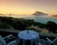 View of Isola Tavolara at sunset from the terrace<br /> of a villa in Porto Taverna, Sardinia, Italy