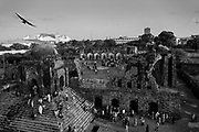 20th August 2015, New Delhi, India. View of the semi-ruined mosque as worshippers gather for Namaz in the ruins of Feroz Shah Kotla in New Delhi, India on the 20th August  2015<br /> <br /> PHOTOGRAPH BY AND COPYRIGHT OF SIMON DE TREY-WHITE a photographer in delhi<br /> + 91 98103 99809. Email: simon@simondetreywhite.com<br /> <br /> The13th century fortress-city of Firoz Shah Kotla in Delhi is thronged weekly with thousands of supplicants seeking favour from supernatural beings of smokeless fire, - Djinns. These magical entities also known as Jinn, Jann or Genies spring from Islamic mythology as well as pre-Islamic Arabian mythology. They are mentioned frequently in the Quran and other Islamic texts and inhabit an unseen world called Djinnestan. Believers, mostly Muslim but from other faiths too, circumnavigate the ruins clutching dozens of photocopied requests, flower petals, incense, and candles. They visit the numerous niches and alcoves in the catacombs said to be occupied by different djinns and greet and salute the invisible occupants with offerings.  A copy of their requests, often with detailed contact information, photographs and even police reports to bolster the case is left with the 'Baba' before moving on to the next where the procedure is repeated - like making applications at different departments of a bureaucracy.