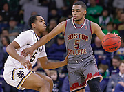 SOUTH BEND, IN - JANUARY 12: Wynston Tabbs #5 of the Boston College Eagles dribbles the ball against D.J. Harvey #5 of the Notre Dame Fighting Irish at Purcell Pavilion on January 12, 2019 in South Bend, Indiana. (Photo by Michael Hickey/Getty Images) *** Local Caption *** Wynston Tabbs