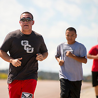 082813       Brian Leddy<br /> A.J. Noriega, Patrick Largo and Johnson Lee jog Along South Second Street Thursday morning. The men were on a training run in preparation to pass the McKinley County Sheriff's Officer physical test.