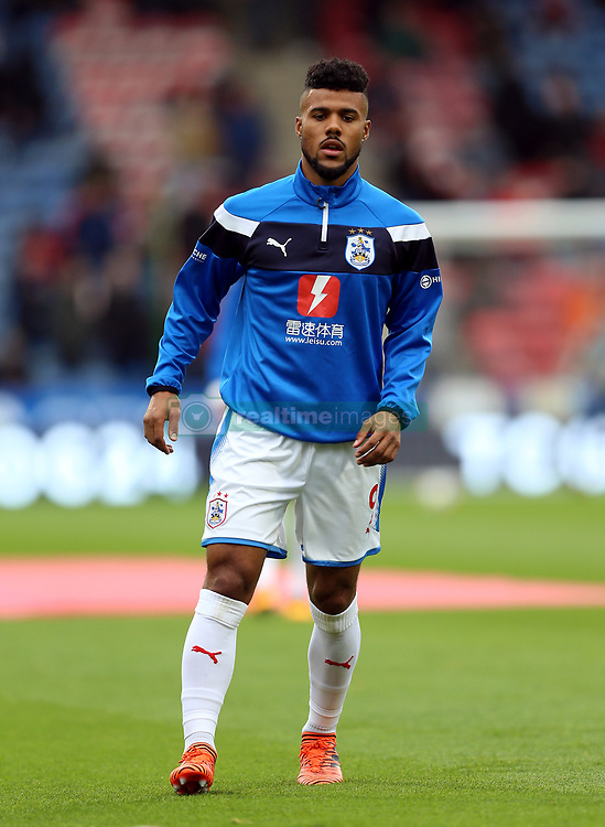 Huddersfield Town's Elias Kachunga warms up before the Premier League match at the John Smith's Stadium, Huddersfield