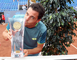 BUDAPEST, April 30, 2018  Italy's Marco Cecchinato kisses the trophy during the awarding ceremony after winning the men's singles final at the Hungarian Open ATP tournament in Budapest, Hungary on April 29, 2018. Cecchinato won 2-0 and claimed the title. (Credit Image: © Attila Volgyi/Xinhua via ZUMA Wire)