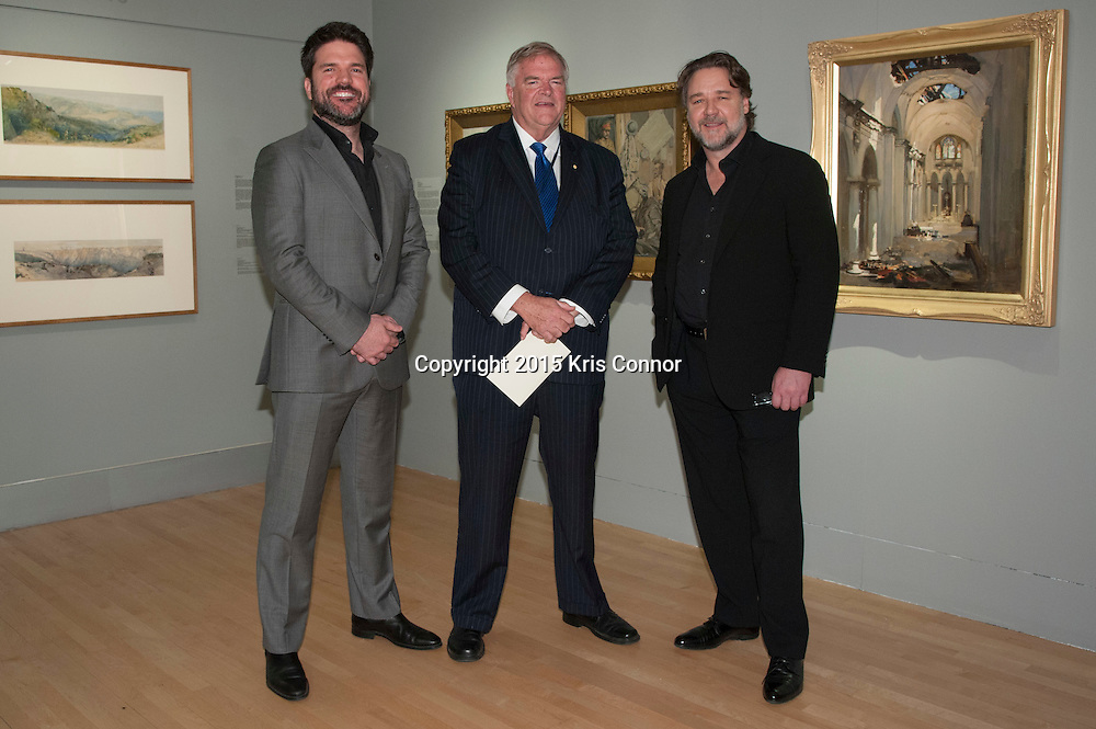 "Producer Keith Rodger, Russell Crowe and The Hon Kim Beazley, Ambassador of Australia, during a viewing of the ""A Centenary of Australian War Art"" exhibit at the Embassy of Australia in Washington DC on April 7th, 2015. Crowe and Rodgers are visiting the nation's capitol to promote the new Warner Bros. Pictures' movie ""The Water Diviner,"" which will be release on April 24th. Photo by Kris Connor for Warner Bros. Pictures"