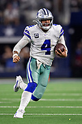 ARLINGTON, TX - OCTOBER 6:  Dak Prescott #4 of the Dallas Cowboys runs the ball during a game against the Green Bay Packers at AT&T Stadium on October 6, 2019 in Arlington, Texas.  The Packers defeated the Cowboys 34-24.  (Photo by Wesley Hitt/Getty Images) *** Local Caption *** Dak Prescott