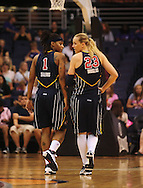 Aug 8, 2010; Phoenix, AZ, USA; Indiana Fever guard Shavonte Zellous and teammate guard Katie Douglas talk during a free throw during the first half at US Airways Center.  Mandatory Credit: Jennifer Stewart-US PRESSWIRE