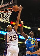 Jan. 30, 2011; Phoenix, AZ, USA; Phoenix Suns guard Vince Carter (25) blocks New Orleans Hornets center Emeka Okafor (50) shot during the first half at the US Airways Center. Mandatory Credit: Jennifer Stewart-US PRESSWIRE