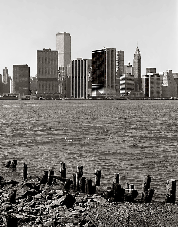 Broken down docks in Red Hook, Brooklyn, looking towards Manhattan. About 1978.